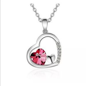 Silver tone heart necklace with red stone heart